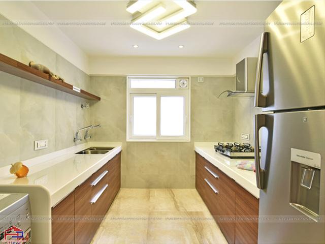 Bộ tủ bếp được thiết kế với tủ bếp dưới màu vân gỗ sang trọng, tiện nghi