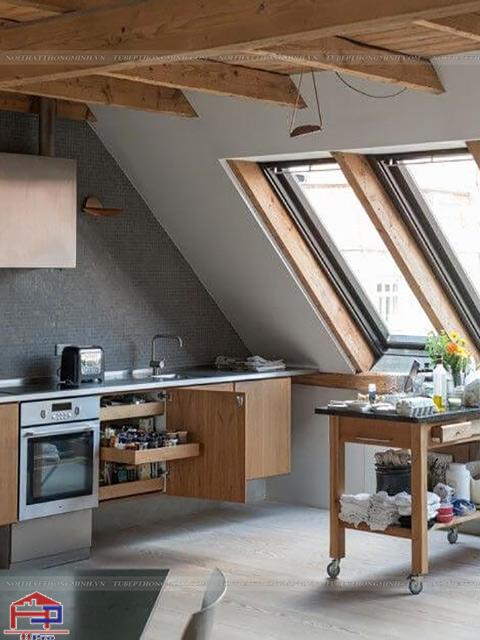 Không gian bếp nhỏ được bố trí mẫu tủ bếp dưới bằng chất liệu gỗ veneer mang đến cảm giác ấm cúng