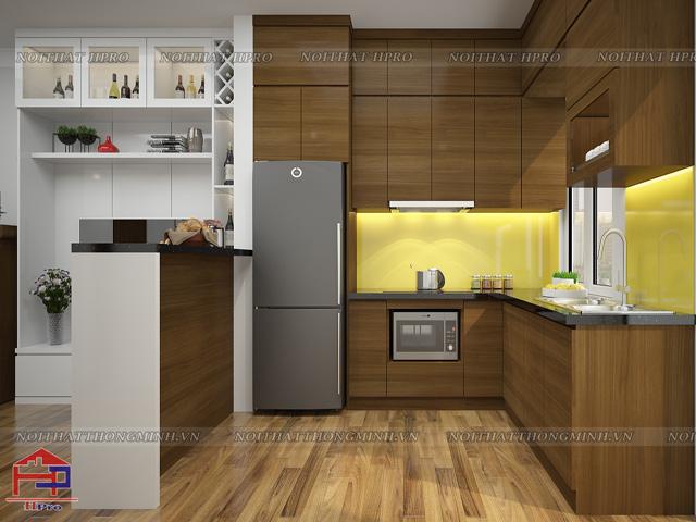 TỦ bếp gỗ veneer đẹp được thiết kế quầy bar bếp như vách ngăn giữa phòng khách và phòng bếp tiện nghi