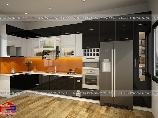 Bộ tủ bếp đẹp nhà chung cư được thiết kế kết hợp màu đen- trắng cùng kính cường lực màu cam cực kì ấn tượng