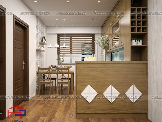 Bộ tủ bếp đẹp được thiết kế thêm quầy bar mini với họa tiết trang trí ấn tượng, chất liệu gỗ sồi mỹ tự nhiên màu nâu vàng sậm nhưng lại mang đến không gian bếp hiện đại