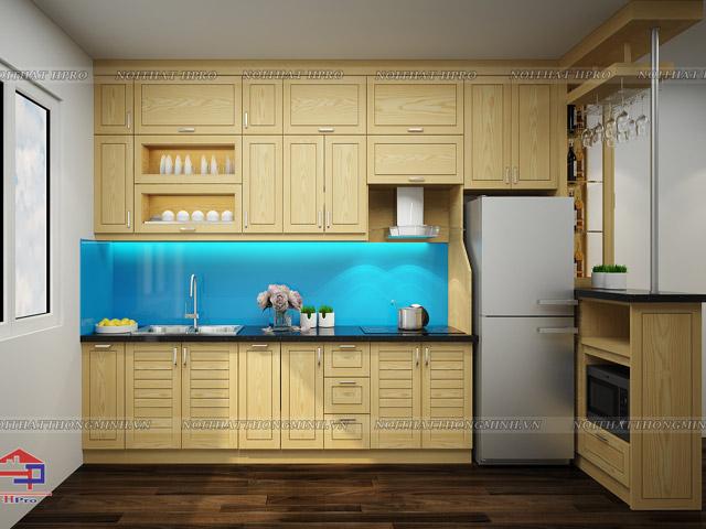 Bộ tủ bếp đẹp bằng gỗ sồi nga tự nhiên màu vàng sáng trẻ trung được thiết kế kèm quầy bar mini hiện đại, tinh tế