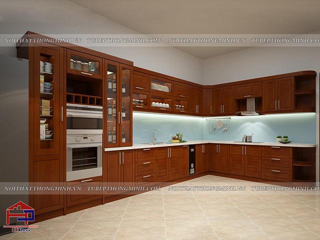 Không gian phòng bếp rộng rãi được thiết kế bộ tủ bếp đẹp bằng chất liệu gỗ xoan đào tự nhiên màu cánh gián cực kì sang trọng
