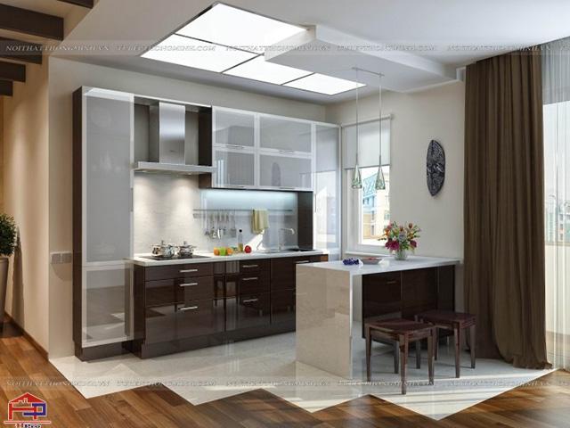 Không gian nhà bếp sang trọng, hiện đại được thiết kế các mẫu tủ bếp nhôm kính đẹp kết hợp bàn đảo bếp tiện dụng