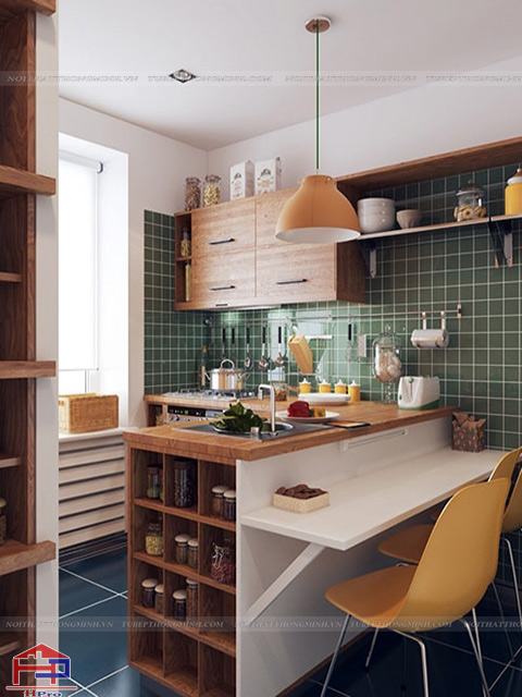 Bếp nhỏ đẹp được bố trí ấn tượng với việc bài trí những đồ dùng nhà bếp màu sắc ấn tượng trên bàn bếp