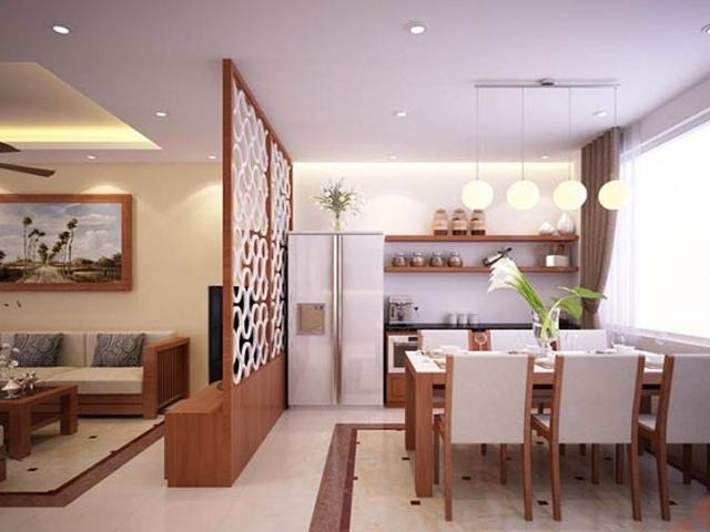 Với những không gian căn hộ chung cư có diện tích nhỏ hẹp thì thiết kế vách ngăn phòng khách và bếp kèm kệ ti vi sẽ là lựa chọn hoàn hảo nhất