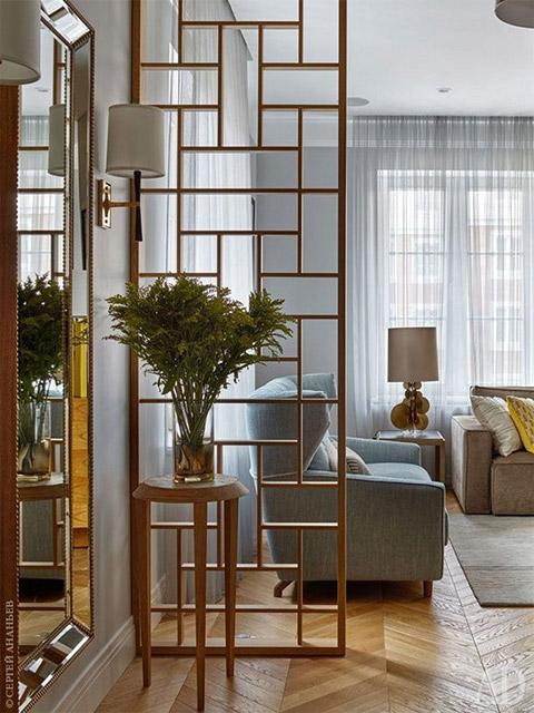 Dù chỉ là những thanh gỗ ghép lại nhưng mẫu thiết kế vách ngăn phòng khách và bếp dưới đây sẽ là sự lựa chọn hoàn hảo cho gia đình bạn