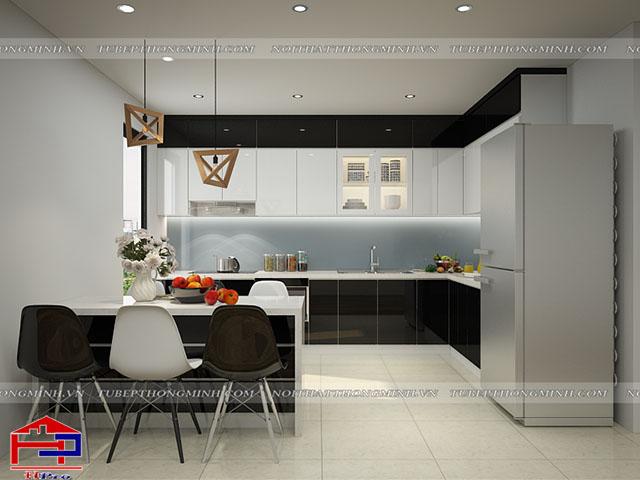 Phòng bếp nhà chung cư có diện tích không quá lớn được bố trí bộ tủ bếp kịch trần và bàn đảo có tác dụng như bàn ăn cực tiện ích