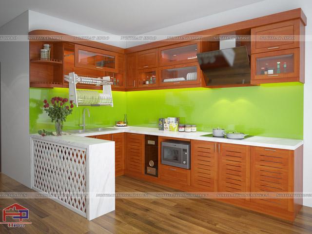 Hình ảnh phòng bếp đẹp từ chất liệu gỗ xoan đào hoàng anh tự nhiên mang lại không gian ấm cúng, gần gũi. Điểm nhấn để tạo nên sự hiện đại cho gian bếp đó là bàn đảo bếp màu trắng với thiết kế nan chéo đan xen cực lạ mắt