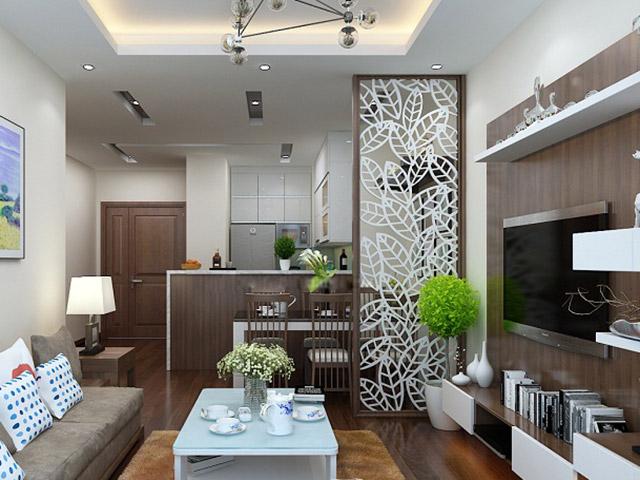 Mẫu phòng bếp chung cư đẹp được thiết kế liên thông với phòng khách, vách ngăn họa tiết CNC ấn tượng giúp phân chia rõ ràng khu vực phòng bếp và phòng khách