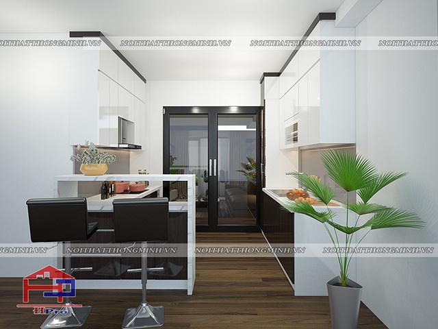 Mặc dù không gian phòng bếp hẹp nhưng vẫn được tận dụng triệt để cho bộ tủ bếp kết hợp quầy bar mini nhỏ xinh cực kì tiện lợi