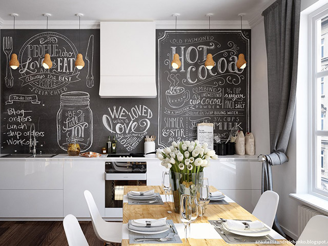 Màu trắng chủ đạo trong không gian phòng bếp chung cư đẹp. Điểm nhấn đó là bức tường được vẽ cực kì ấn tượng thể hiện cá tính của nhà