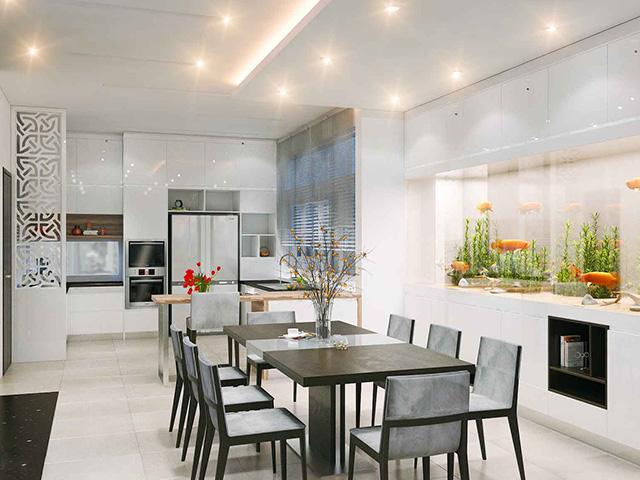Mẫu phòng bếp đẹp hiện đại với kích thước rộng rãi được bố trí đầy đủ tiện nghi và còn có thêm bể cá cảnh- mang thiên nhiên vào không gian sống