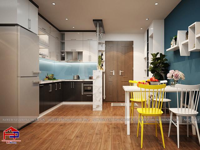 Nhà bếp 12m2 hiện đại và tiện nghi bằng chất liệu gỗ công nghiệp acrylic An Cường màu đen - trắng chủ đạo ấn tượng. Điểm nhấn cho không gian là những chiếc ghế ăn màu vàng bắt mắt