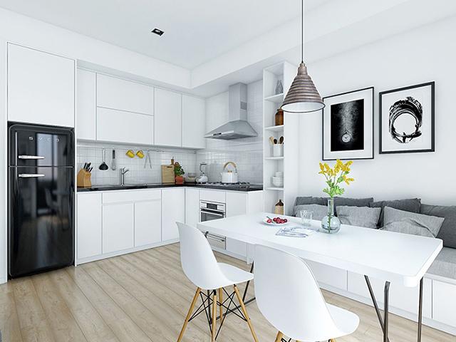Mẫu nhà bếp 12m2 thiết kế liên thông với phòng khách sử dụng gam màu trắng chủ đạo mang đến sự tinh tế và giúp nới rộng không gian diện tích cực hiệu quả