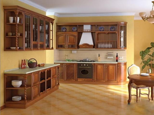 Phòng bếp theo phong cách cổ điển được thiết kế mẫu tủ bếp gỗ căm xe đẹp với màu nâu đỏ. Những chi tiết, đường nét từ mặt cánh tủ cổ điển tạo nên nét quý phái, lịch lãm và ấn tượng riêng cho căn phòng